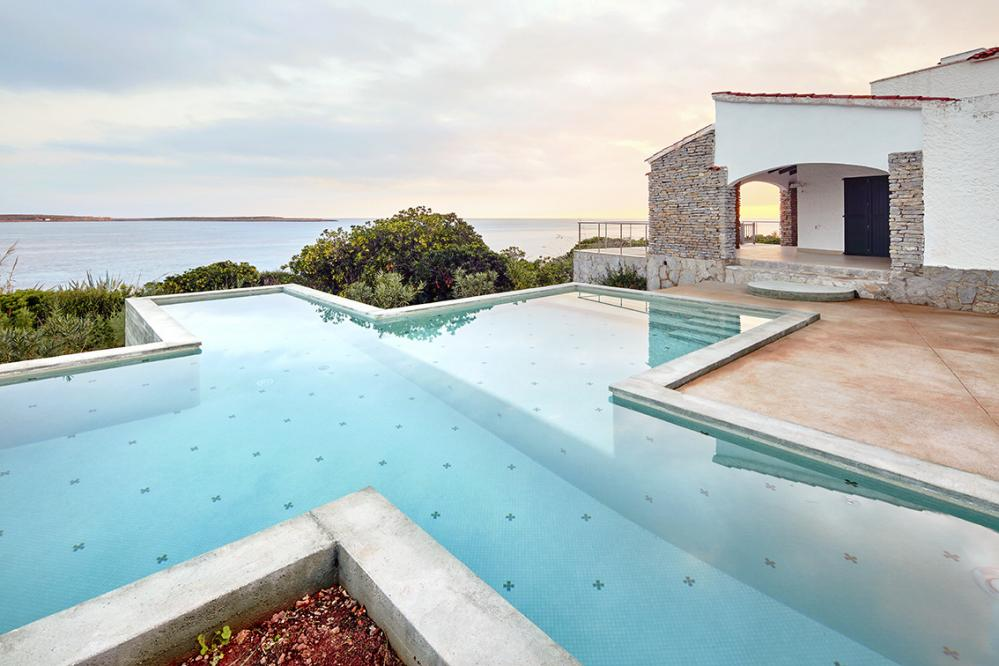 Villa Aire perched on the seafront with uninterrupted views to sea of Punta Prima.