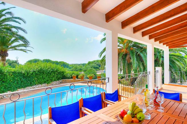 Charming villa is located in Binibèquer, Menorca  and overlooking the beach.