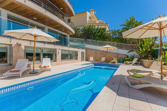 Superb frontline villa for rent in Puerto Alcudia, Mallorca